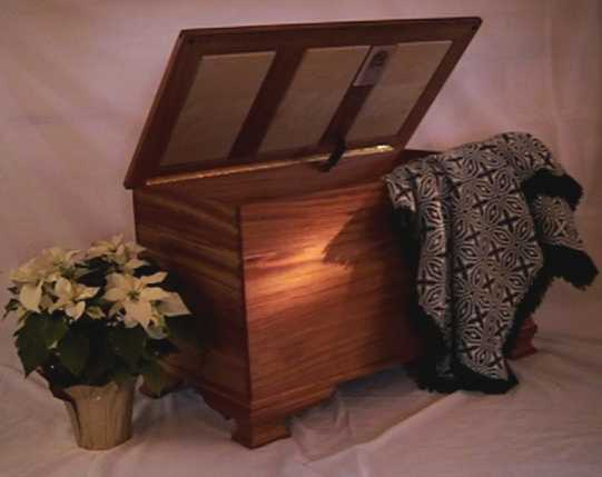 African Mahogany blanket chest in Walker style with tripple frame lid and scroll feet